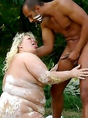 Blonde BBW Cynthia entices her boyfriend by rolling on a white mud before fucking