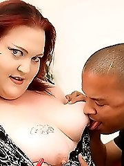 Redhead fatty enjoying a huge black cock