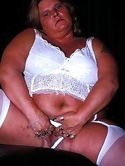Plumper poser spreads in her white stockings