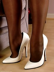 A gorgeous brunette relaxing at home with her stiletto heels on