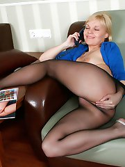 Hot blondie pleasuring her pussy encased in black sheer-to-waist pantyhose