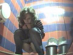 Voyeur peeps after hot babes in public toilet