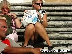 Unsuspecting girls inminiskirts spread tanned legs in public and get filmed