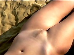 Two almost naked lovers of beach sun caught on tape
