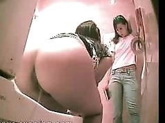 Asian hotties secretlyfilmed as they pull down tiny panties to take a piss