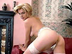 Smooth blonde undressing her lingerie shows off ass and her bushy pussy