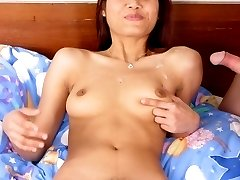 Exotic Asian model strip off her clothes and jump on top of a stiff cock to take in in her hairy...