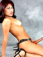Petite Latina Wields A Massive Strap-On