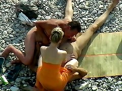 Two males and a girl have some bisexual beach fun