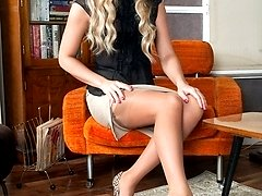 Natalia relaxing in the drawing room in quarter cup bra and chic nylons!