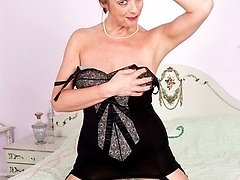 Feeling frisky Lou strips down to her vintage corselette and nylons!