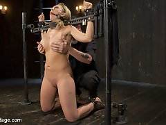 Kagney is new to this and is eager to change that. She wants to know what she has been missing ou ton, so we lock this busty blonde slut into our first device. The Pope goes between pain and pleasure to fuck with her, yet not break her out of the gate. After she orgasms harder than she ever has, and not even sure why, we move to the next positions. Each one more grueling than the previous one to ensure she suffers. She is taken down a path of S&M, shown what real domination is, then made to orgasm. Her mind is still trying to comprehend what has happened to her, and she knows that whatever it is, she wants more.