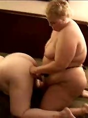 Big belly blonde BBW uses her strap on dildo