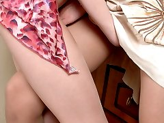 Lascivious babe putting on new tights for pussy-licking right through nylon