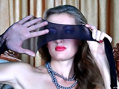 Footsie teaser slowly dons her classy black stockings and strappy sandals
