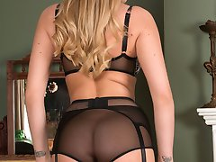 Danielle loves to tease in her grey deep top sheer nylons as she strips and poses playing in her...