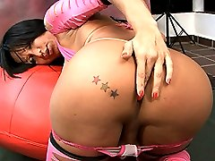 Brunette TS Leticia playing with her huge fat cock