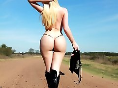 Huge Tits tranny shows her great body in the middle of the road