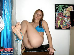 Bikini slut stretches legs and shows pussy bikini