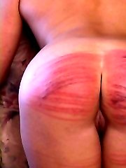 Pretty girl stripped naked in the front room and severely whipped on her lovely ass