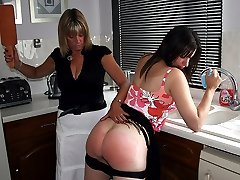 Lovely girl's firm ripe buttocks reddened with a leather paddle in the kitchen