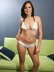Young tattooed brunette slut slides her bikini bottoms up her camel toe slit