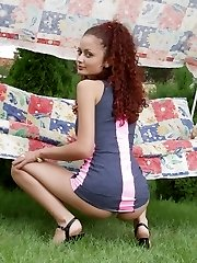 Curly amateur redhead teen babe strips outdoors