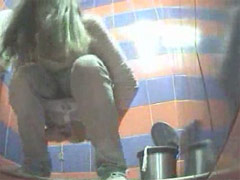 Hot blonde exposed to spy cam in public loo