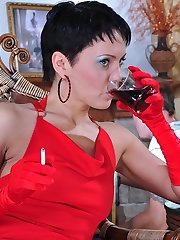 Dominative lady in red shoves her gloved fingers and toy into the male butt
