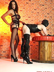 Strapon Jane humiliates her latex slut with her big red strapon cock and sharp pointy high heels