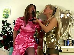 Sissy in a satin dress getting his butt massaged by an extra equipped chick