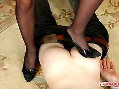 Lusty gal with strap-on treating her boyfriend like her bitch for anal sex