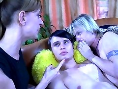 Wild bisexual action with two guys taking strapon abuse from a bossy chick
