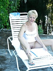 Tracy bares all outdoors in this naughty lake side photo shoot