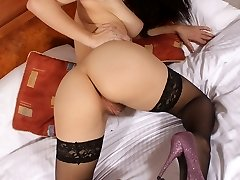 Roxy Mendez plays on the bed in her sexy lingerie and basque before stripping off and peeling...