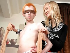 Blindfold sissified guy in sheer stockings ready for harsh strap-on attack