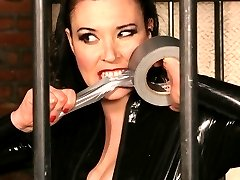 Mistress Anastasia Pierce in a cage giving her male slave a good dose of ass canning