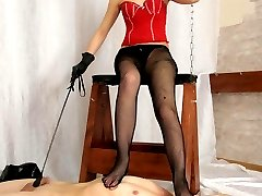 She sits on a goat for spanking and the slave creeps before her in a lap and licks her high...