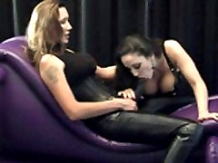 Busty brunette sucks Janes strapon then rides her
