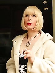 Luci May punishes her naughty smoking crossdresser maid with her hands and whips