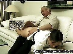 She tries to cover her round ass, but her stepfather pulls her hand away and lands another hard slap. He seems to enjoy disciplining his step daughter.