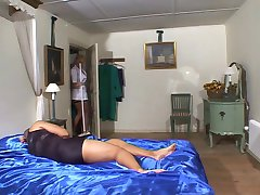 British maid gets fucked on the bed in fishnets