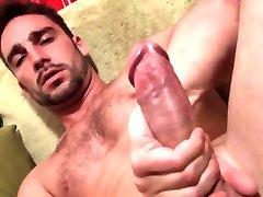 Sexy jock tugs cock solo