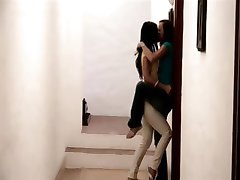 Lesbian sensual kiss in close-up with two beauties