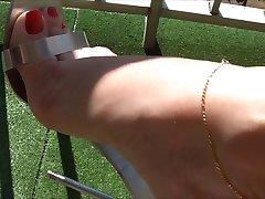Sexy feet in metal heels 1