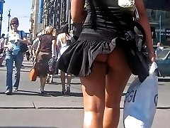 A girl in dress and panties in this outdoor upskirt gelery