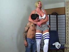 Tall goddess beating up a guy