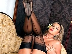 Natalias sexy and silky dress over her sheer nylons turns her on!