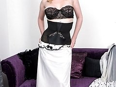 Bedtime for Holly in her vintage negligee over classic strapless bullet bra and high waisted...
