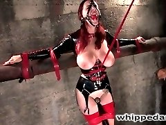 The fabulous Berlin is back looking very sexy in tight latex with her huge DD breast exposed....